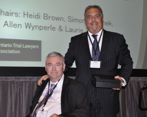 Barry Munro and Joseph Falconeri, of Falconeri Munro Tucci LLP, accepting the award on behalf of Play It Cool.