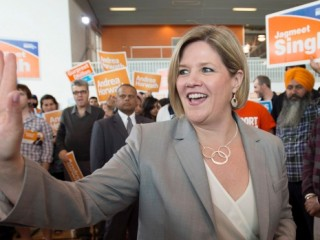 Ontario NDP Leader Andrea Horwath waves to supporters during a campaign stop in Brampton, Ont. on Saturday, May 10, 2014.