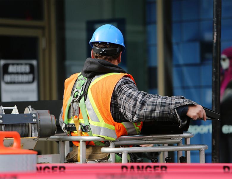 construction worker at a dangerous job site