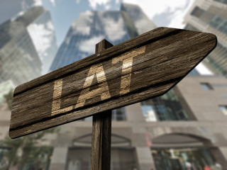 signpost reads LAT in front of FSCO offices in Toronto