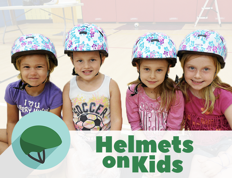 4 girls wear their new bike helmets