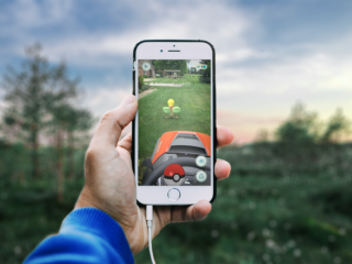 smartphone displays image of pokemon go gameplay