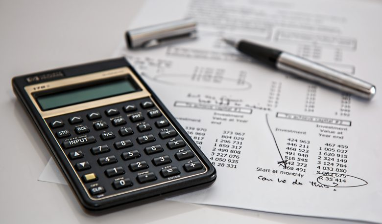 Calculating economic loss using a calculator and spreadsheet
