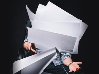 Frustrated by confusing LTD coverage, a man throws papers into the air